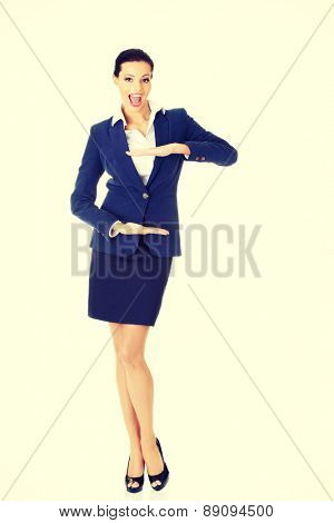 Young beautiful businesswoman gesturing frame