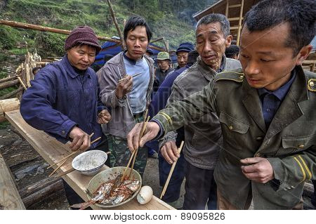 Sharing Food On A Rural Celebration, Local People Farmers, China.