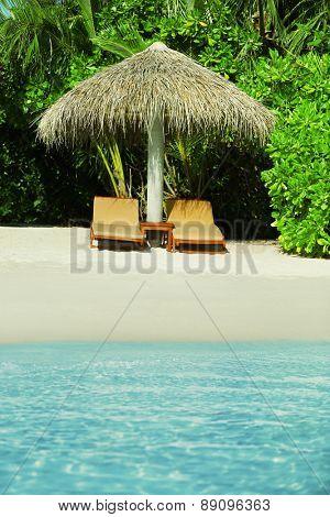 Sunbeds on beautiful beach in resort