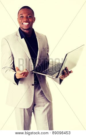 Black handsome man standing with the laptop