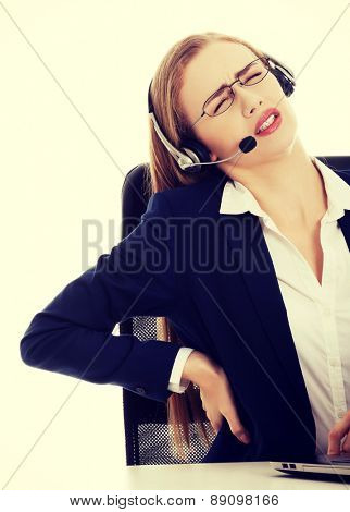 Beautiful businesswoman with back pain