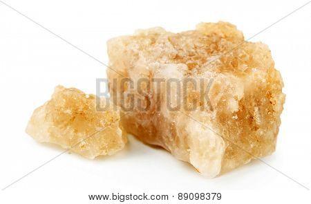Crust of sea salt from Dead Sea coast isolated on white