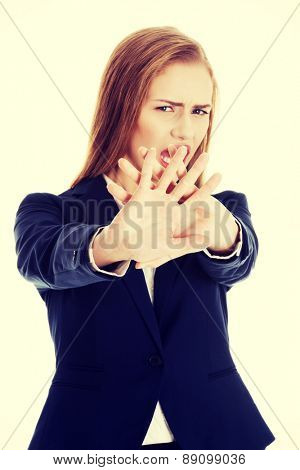 Young businesswoman trying to protect herself