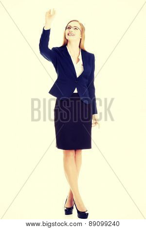 Young blonde businesswoman catching something