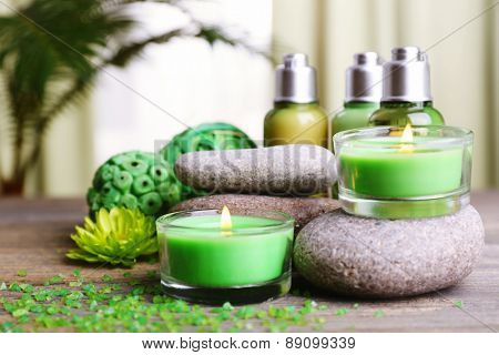 Beautiful spa composition with spa stones and candles on fabric background