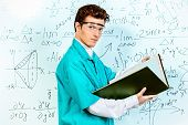 image of conduction  - Young scientist conducting research - JPG