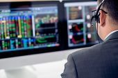 picture of shoulders  - Businessman in a headset looking at the statistics of stock exchange - JPG