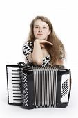 stock photo of accordion  - teenage girl on the floor of studio with accordion against white background  - JPG