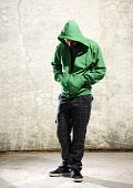 image of hoodie  - Youth with green hoodie and grunge background - JPG