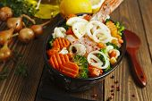 stock photo of redfish  - Fried fish with vegetables in the pot - JPG