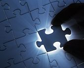 pic of joining hands  - Hands completing jigsaw puzzle Jigsaw and puzzles concepts - JPG