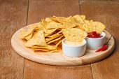 picture of nachos  - nachos with various sauces on wooden table - JPG