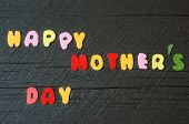 pic of mother-in-love  - Happy mothers day with i love mom message idea from colorful letter on wooden background woman hand cutting character to make gift for mother on happy day show feeling with mother love family - JPG