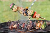 picture of braai  - Tasty skewers on the grill - JPG