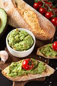 pic of nachos  - Green Guacamole with nachos and avocado on stone background - JPG