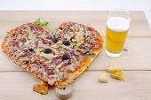pic of olive shaped  - Heart shaped pizza and homemade pastry with a glass of beer on wood - JPG