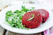 pic of quinoa  - chickpeas quinoa and beet burgers with arugula on a white wood background - JPG