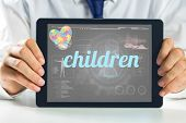 pic of autism  - The word children and autism awareness heart against medical biology interface in black - JPG