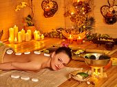 picture of stone-therapy  - Woman getting a lot of white stone therapy massage in oriental spa - JPG