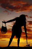 foto of cave woman  - A silhouette of a cave woman in her dress with a hatchet - JPG