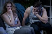 stock photo of terrifying  - Young crying woman and her terrified husband after fight - JPG