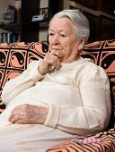 picture of saddening  - Portrait of old sad woman at home - JPG