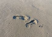 pic of footprints sand  - close up of two footprints in the sand - JPG