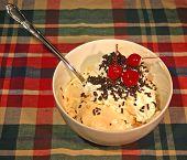 stock photo of jimmy  - gooey ice cream sundae with whipped cream and jimmies - JPG