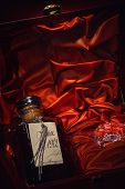 picture of liquor bottle  - Luxurious Bottle Of Armagnac In A Box Made Of Mahogany - JPG
