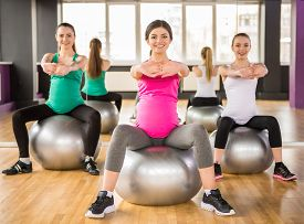 pic of pregnancy exercises  - Fitness sport and lifestyle concept  - JPG
