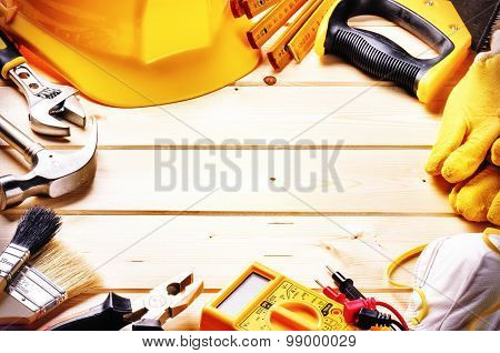 Frame With Various Tools On Wooden Background. Construction Concept