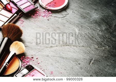 Various Makeup Products In Pink Tone