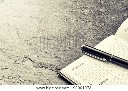 Business Concept With Paper Agenda And Pen