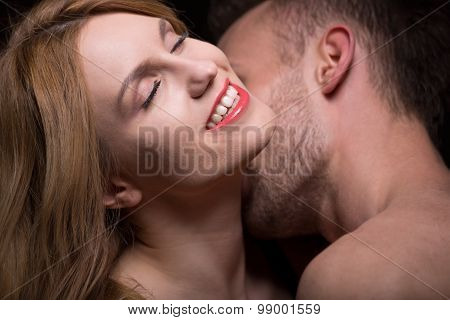 Man Caressing Woman's Neck