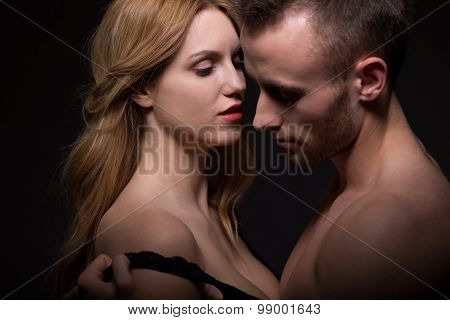 Aroused Man Undressing A Woman