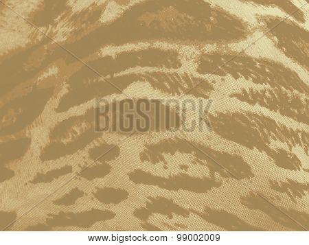 Beige-brown gradiented leopard textile background