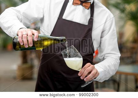 Barman pouring sparkling wine