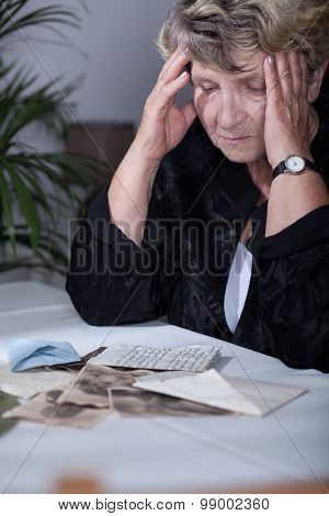 Woman Looking At Family Souvenirs
