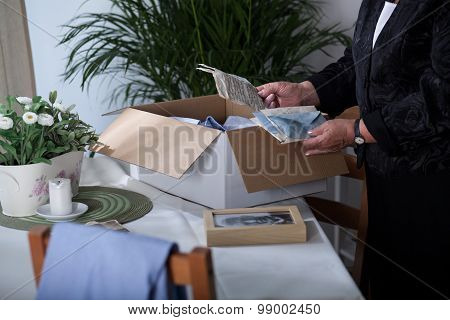 Packing Souvenirs After Dead Husband