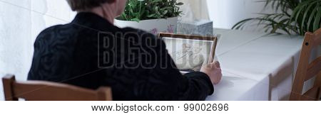 Widow Looking At Picture