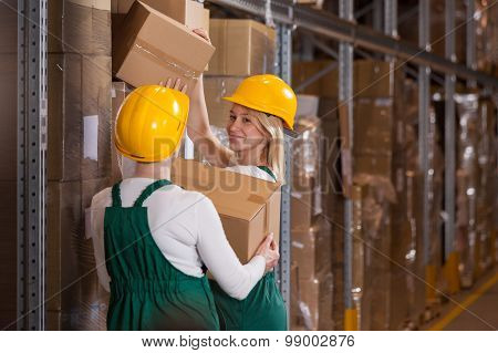 Female Workers In The Warehouse