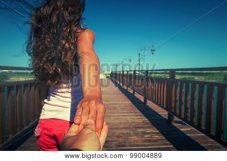 a girl goes on a post holding a fellow on a hand