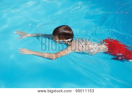 Little Boy Diving In Pool
