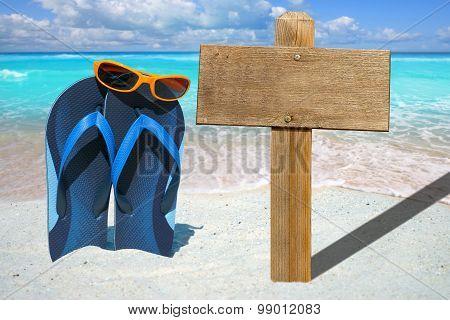 Blue Flip Flops And Wooden Signboard