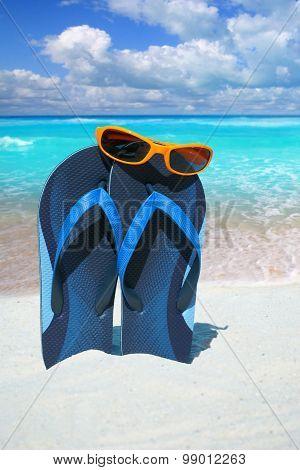 Blue Flip Flops And Sunglasses