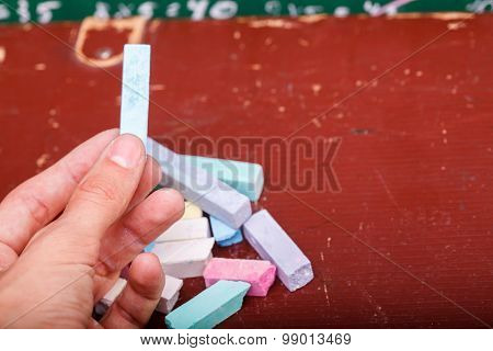 Human Hand And Heap Of Chalk