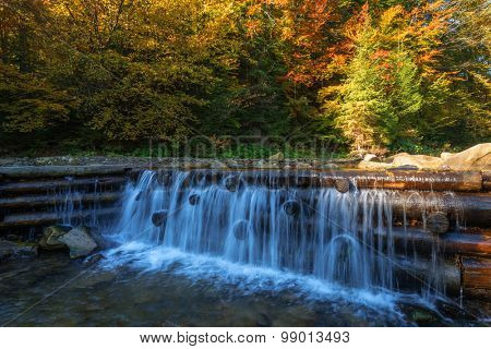 Beauty waterfall in autumn forest