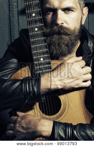 One Attractive Man With Guitar
