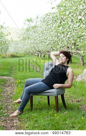 Woman Sitting in a Vintage Chair