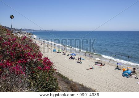 MALIBU, CALIFORNIA, USA - August 15, 2015:  Summer weekend beach goers enjoying the water Topanga State Beach in Santa Monica Bay.